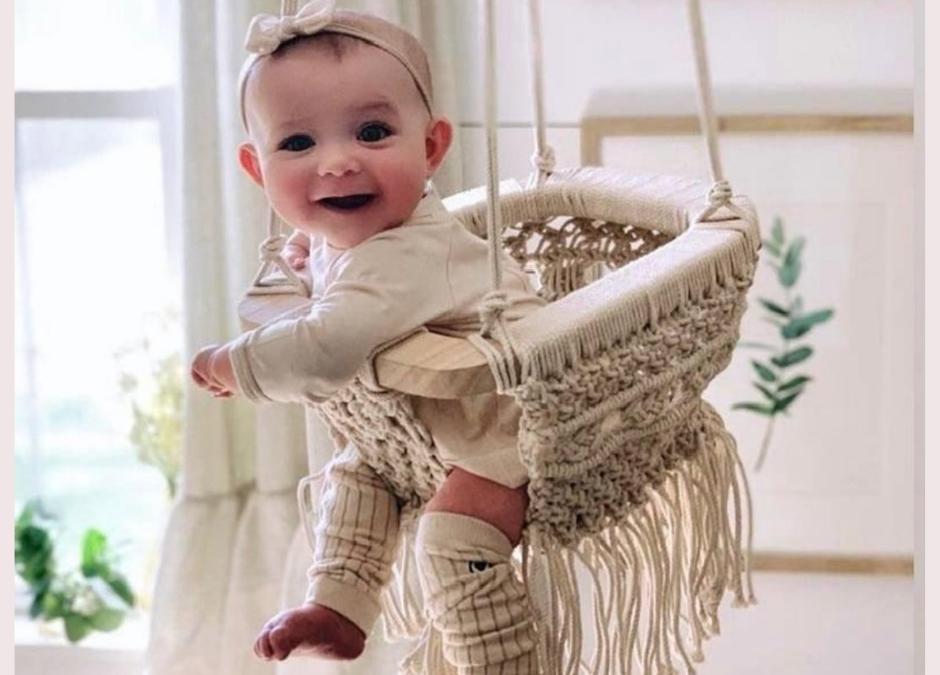 Baby in a Macrame Swing Chair