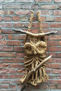 Photo of a macrame owl wall hanging